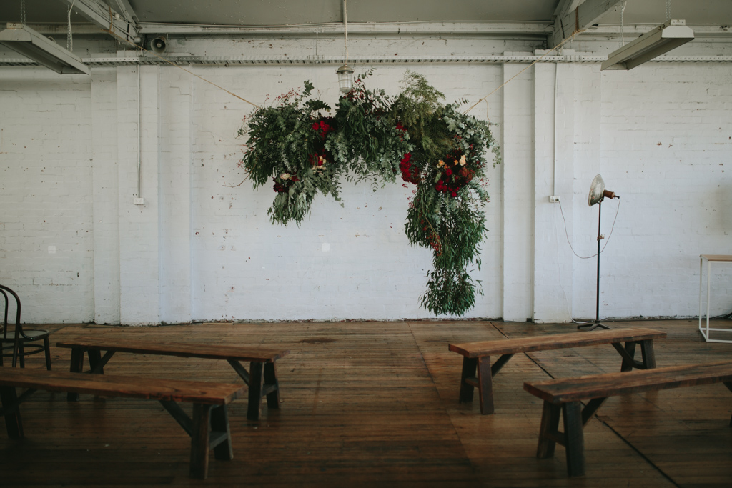 Beautiful raw warehouse venue & stunning floral background!